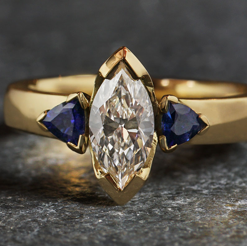 18299-yellow-gold-marquise-diamond-and-trilliant-sapphire-trilogy-engagement-ring_9.jpg