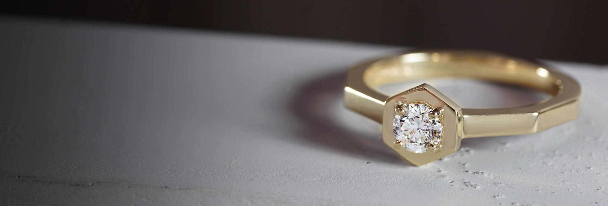 yellow-gold-hexagonal-engagement-ring-with-hexagonal-set-diamond