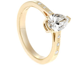 19257-yellow-gold-and-pear-cut-diamond-engagement-ring-with-graining-detail_1.jpg