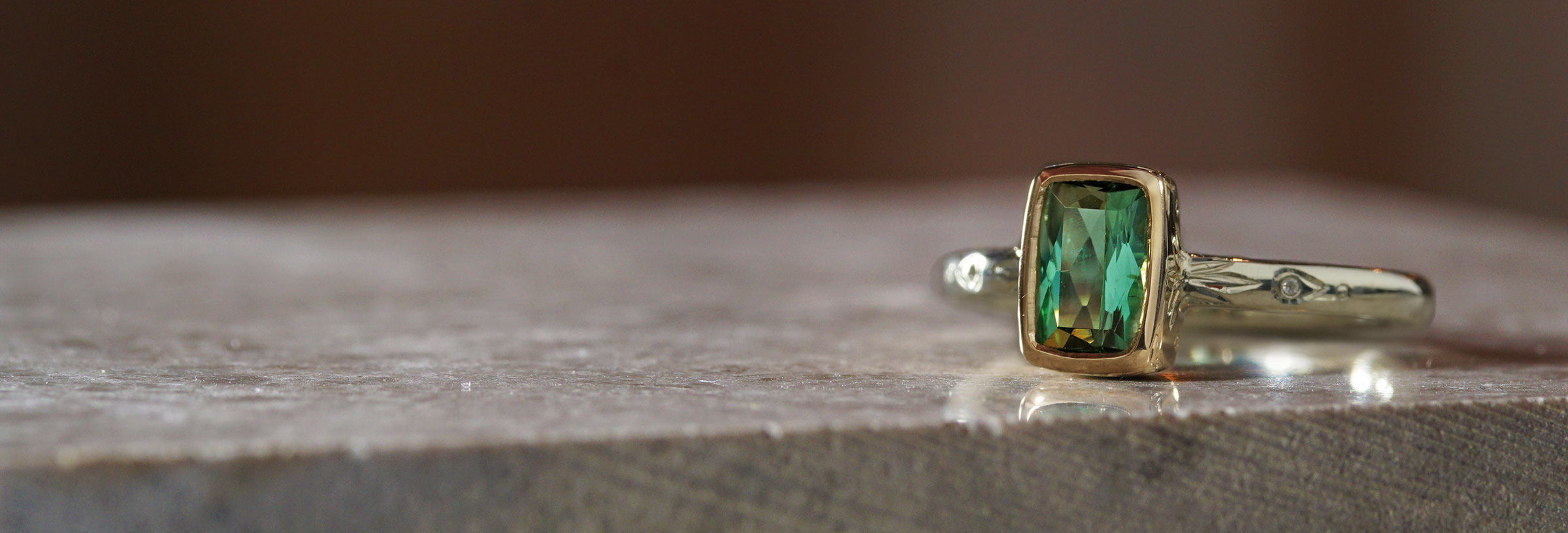 fairtrade-white-and-yellow-gold-mint-tourmaline-engraved-engagement-ring
