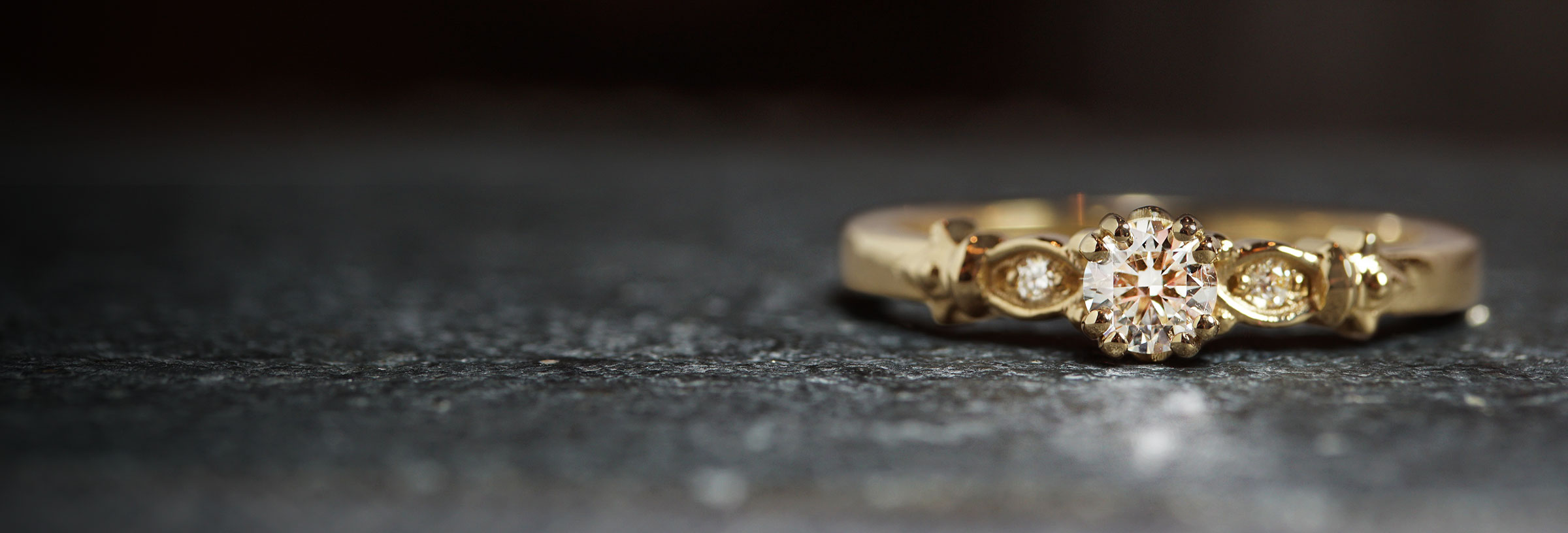 fleur-de-lis-inspired-yellow-gold-and-diamond-engagement-ring