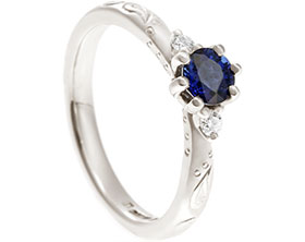 19040-fairtrade-white-gold-diamond-and-sapphire-paisley-inspired-engagement-ring_1.jpg