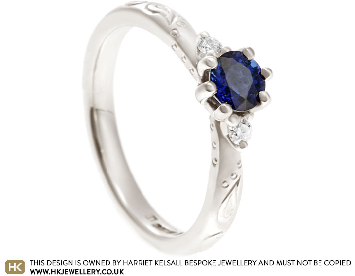 19040-fairtrade-white-gold-diamond-and-sapphire-paisley-inspired-engagement-ring_2.jpg