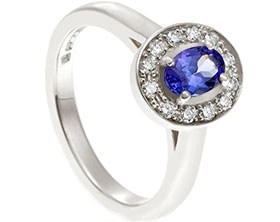 19547-white-gold-tanzanite-and-diamond-halo-engagement-ring_1.jpg