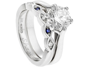 19748-platinum-marquise-shaped-sapphire-and-diamond-wedding-band_1.jpg