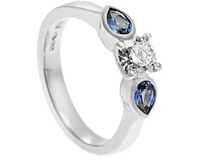 19898-platinum-trilogy-style-engagement-ring-with-diamond-and-pear-cut-sapphires_1.jpg