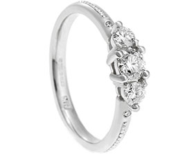 19018-platinum-three-stone-engagement-ring-with-beading-detailing_1.jpg