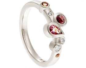19035-white-gold-pink-tourmaline-garnet-and-diamond-scatter-eternity-ring_1.jpg