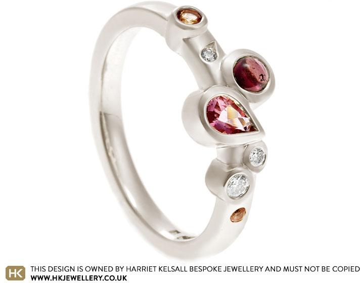 19035-white-gold-pink-tourmaline-garnet-and-diamond-scatter-eternity-ring_2.jpg