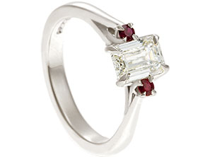 19653-white-gold-trilogy-engagement-ring-with-emerald-cut-diamond-and-rubies_1.jpg