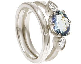 19836-white-gold-diamond-and-tanzanite-trilogy-style-engagement-and-wedding-band-set_1.jpg