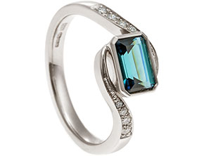 19897-white-gold-twist-style-eternity-ring-with-emerald-cut-blue-tourmaline_1.jpg