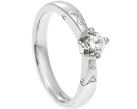 19904-platinum-and-diamond-engagement-ring-with-triskele-engraving_1.jpg
