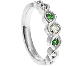 20033-twisting-platinum-diamond-and-green-tsavorite-engagement-ring_1.jpg