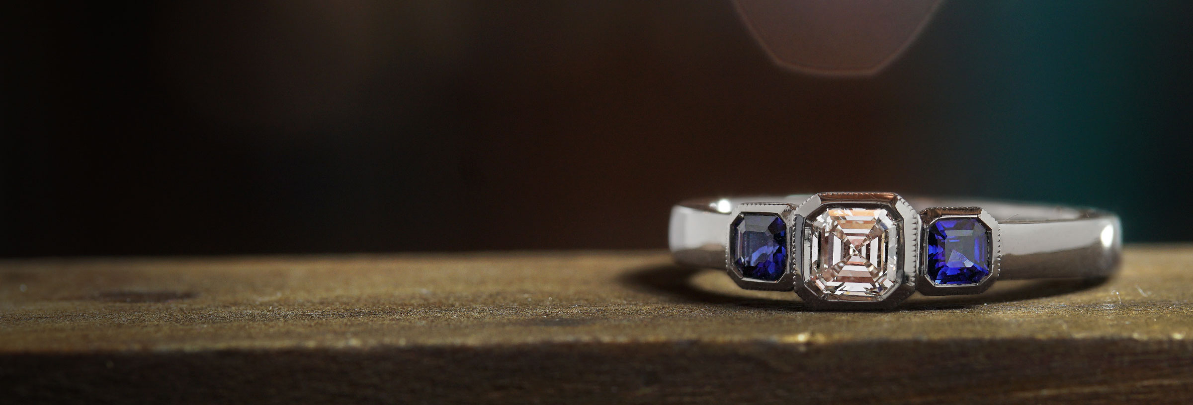 platinum-asscher-cut-diamond-and-octagonal-sapphire-trilogy-engagement-ring