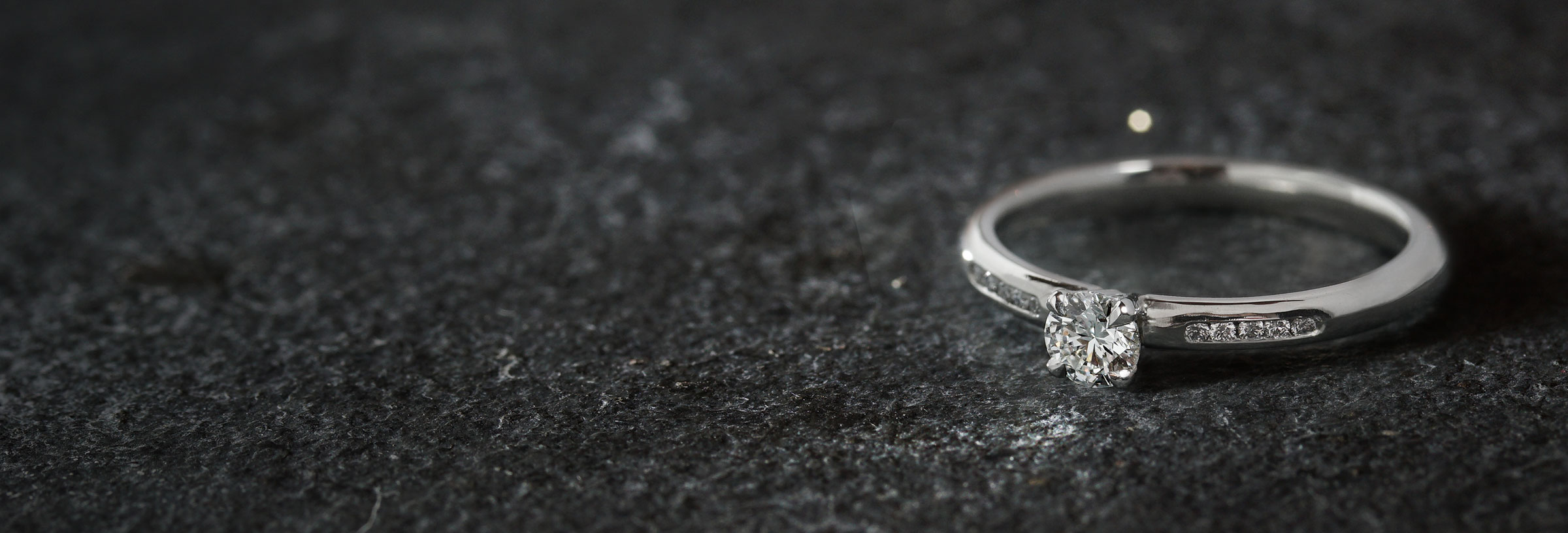 delicate-platinum-and-diamond-engagement-ring-with-channel-set-shoulders