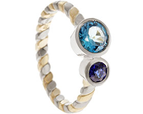 20087-white-and-yellow-gold-twisting-engagement-ring-with-sapphire-and-topaz_1.jpg
