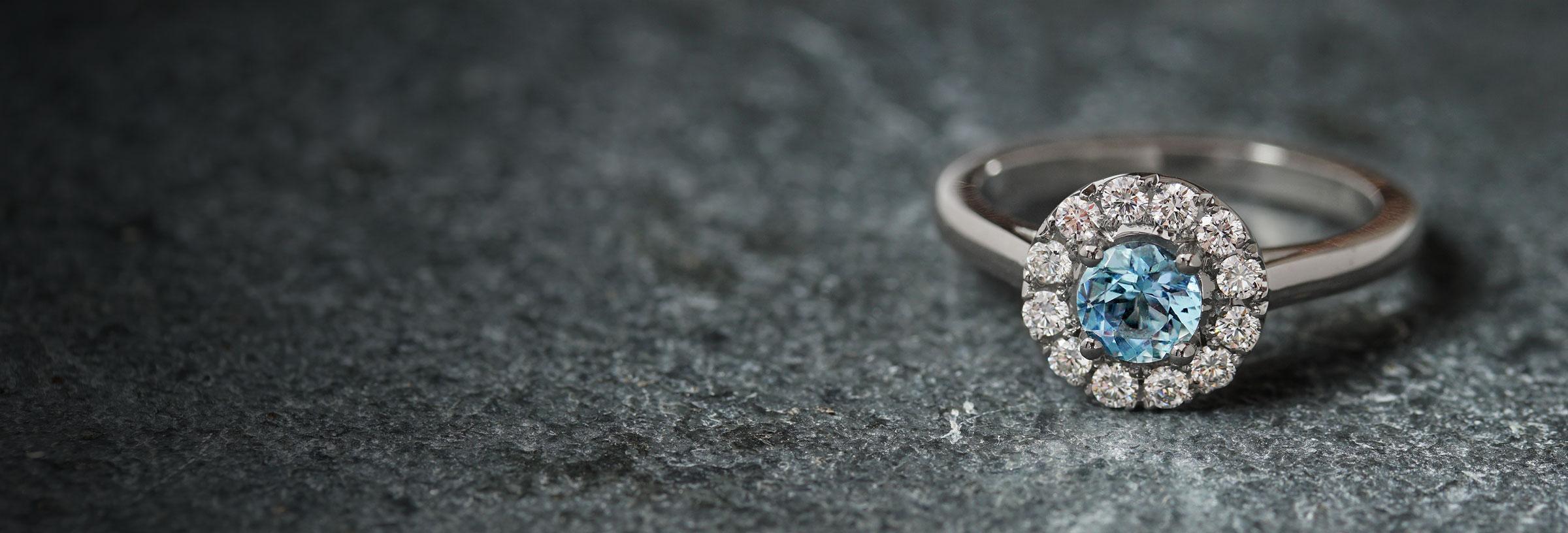 platinum-aquamarine-and-diamond-halo-engagement-ring