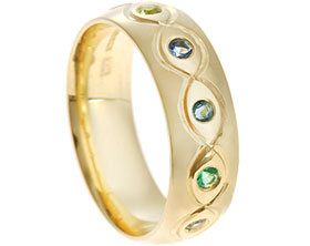 20235-yellow-gold-birthstone-eternity-ring-with-wave-line-engraving_1.jpg