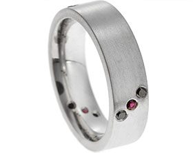 20282-satinised-platinum-eternity-ring-with-black-diamonds-and-rubies_1.jpg