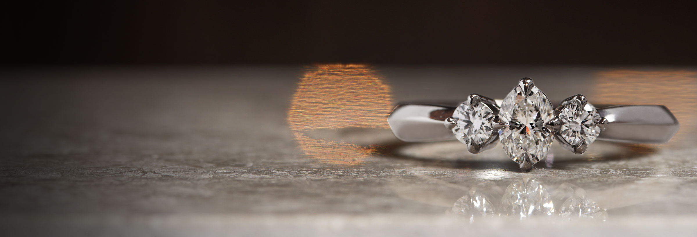 palladium-trilogy-engagement-ring-with-oval-and-round-diamonds