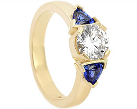 20337-yellow-gold-trilogy-diamond-and-trilliant-cut-sapphire-engagement-ring_1.jpg