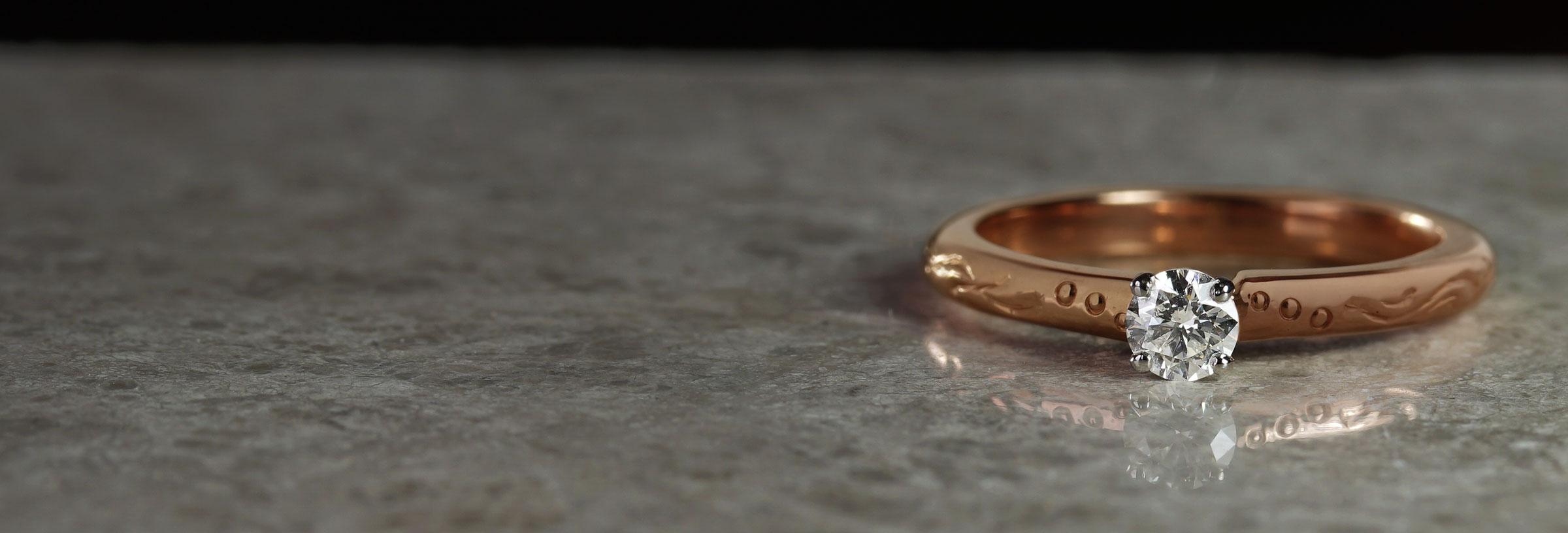 rose-gold-and-palladium-engraved-diamond-engagement-ring