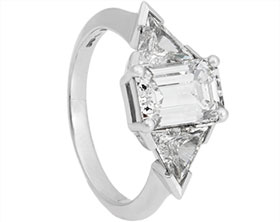 20404-platinum-emerald-and-triangle-cut-diamond-trilogy-engagement-ring_1.jpg