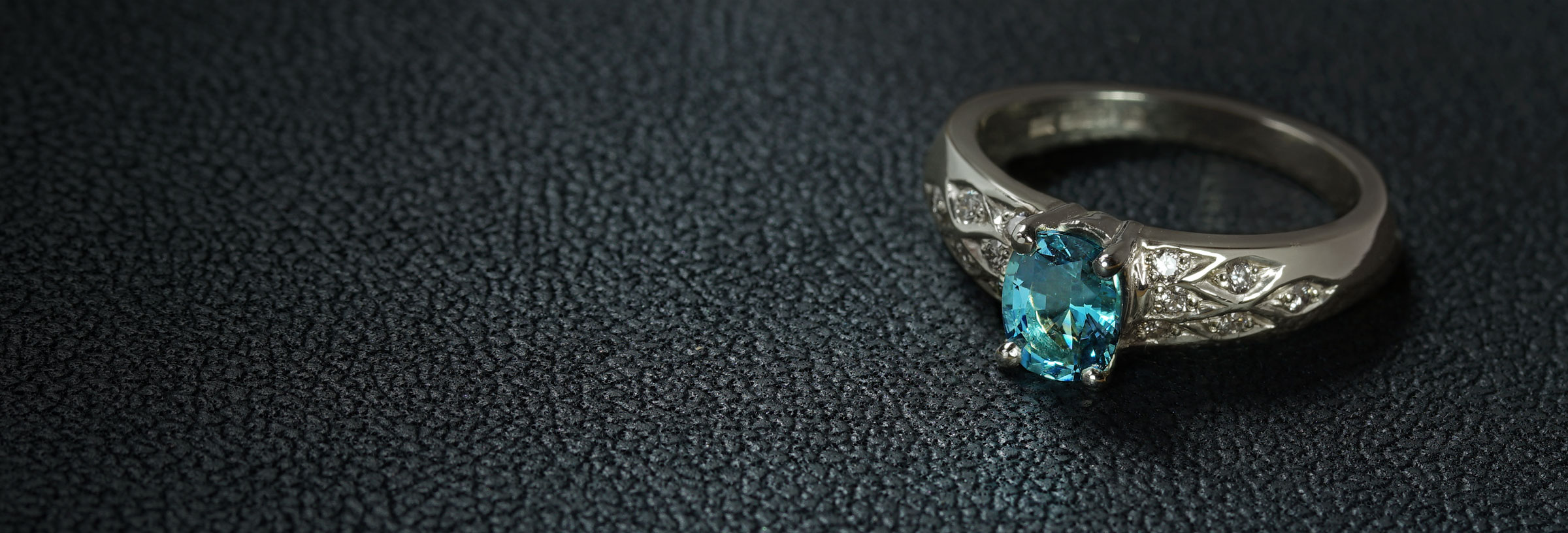 white-gold-aquamarine-and-marquise-grain-set-diamond-engagement-ring