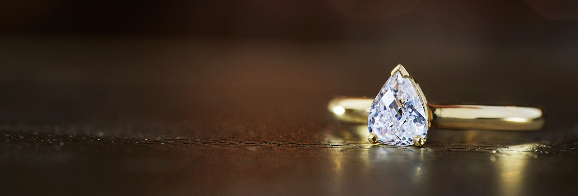 yellow-gold-briolette-cut-pear-shaped-diamond-engagement-ring
