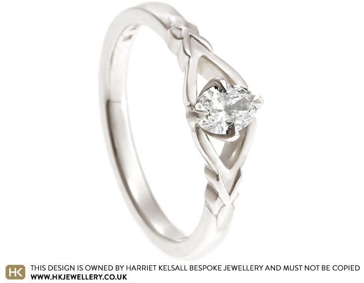 19045-leaf-inspired-fairtrade-white-gold-and-oval-diamond-engagement-ring_2.jpg