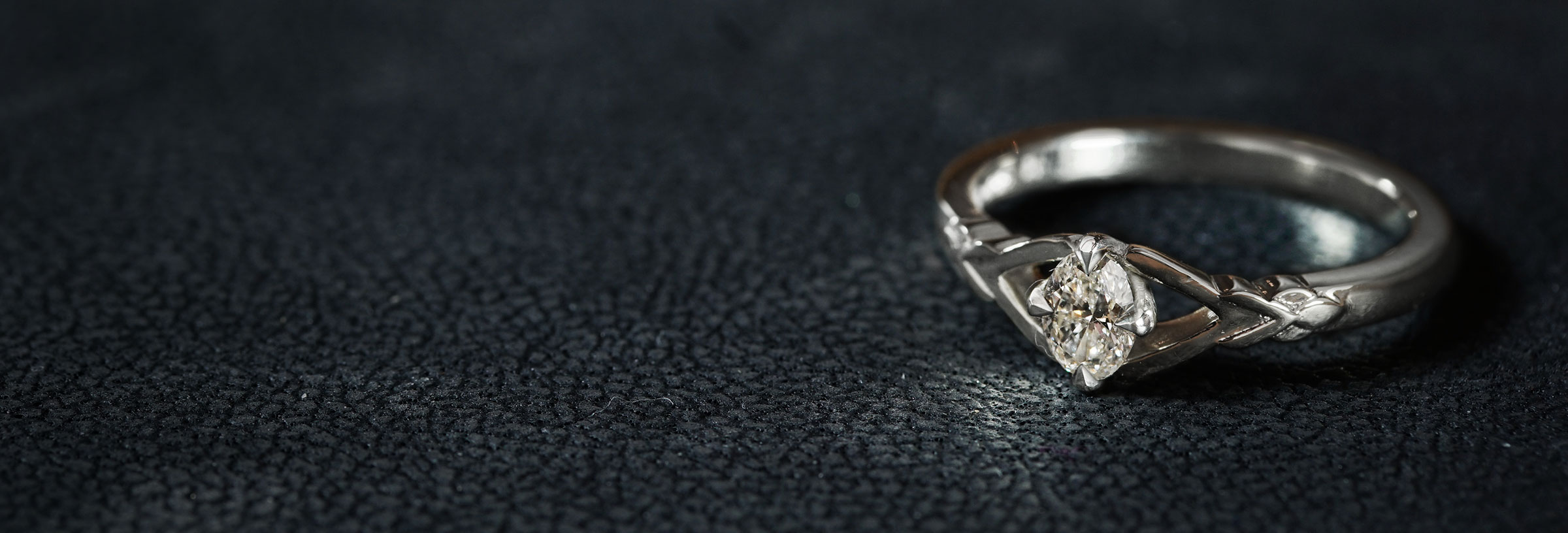 leaf-inspired-fairtrade-white-gold-and-oval-diamond-engagement-ring