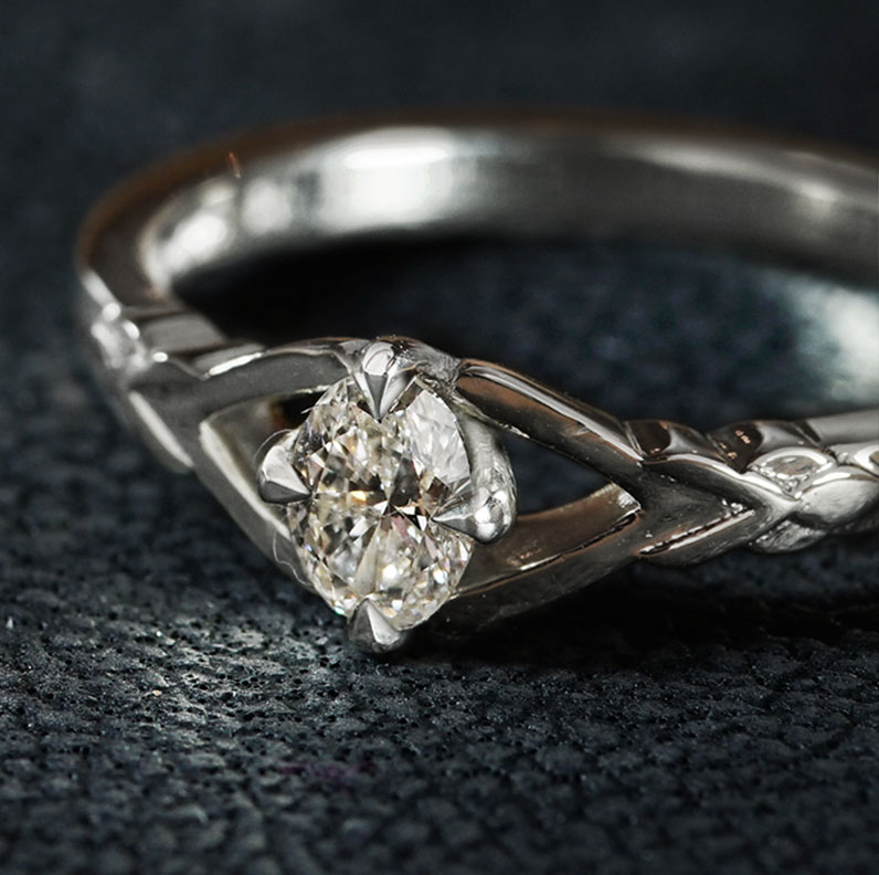 19045-leaf-inspired-fairtrade-white-gold-and-oval-diamond-engagement-ring_9.jpg