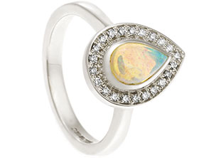 20599-white-gold-pear-shaped-opal-and-diamond-halo-engagement-ring_1.jpg