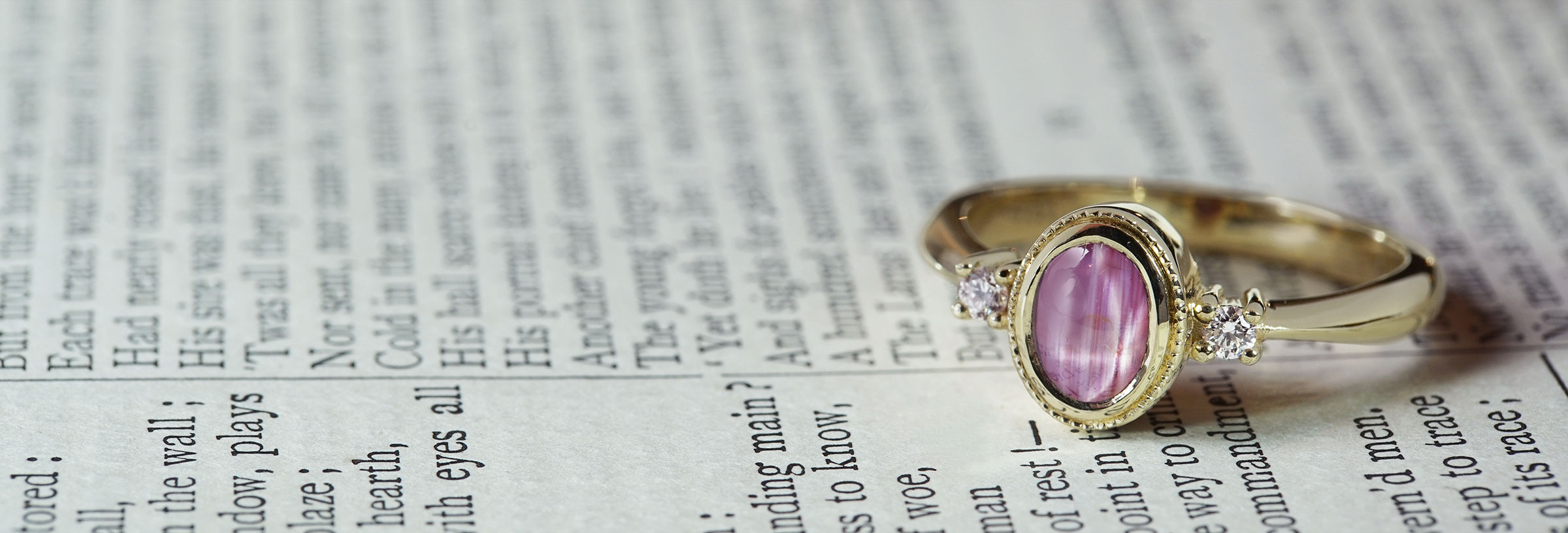 yellow-gold-pink-star-sapphire-and-diamond-trilogy-engagement-ring
