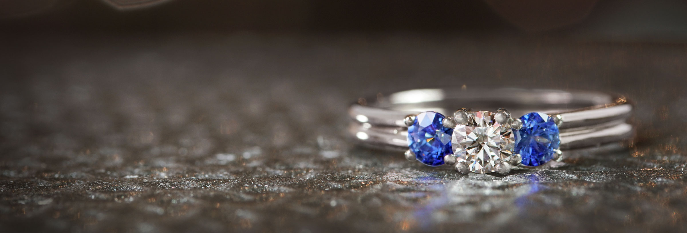 palladium-diamond-and-sapphire-trilogy-engagement-ring