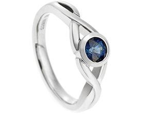 18389-palladium-cross-over-style-blue-sapphire-engagement-ring_1.jpg