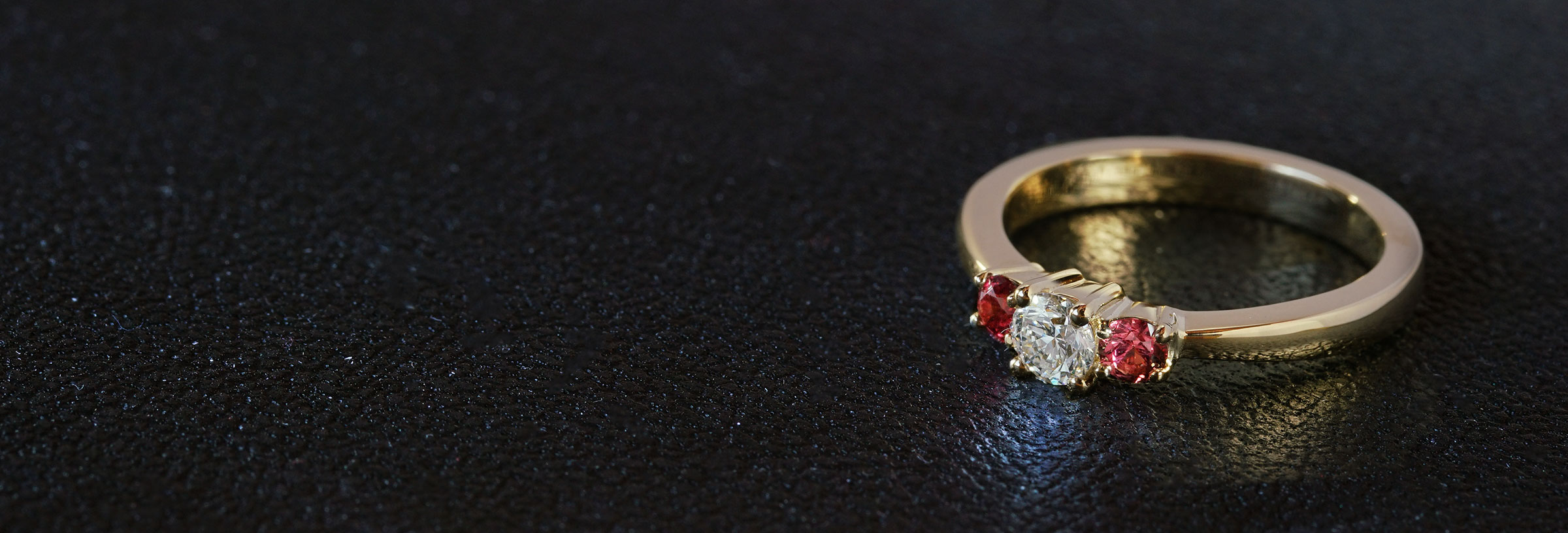 yellow-gold-peach-sapphire-and-diamond-trilogy-engagement-ring