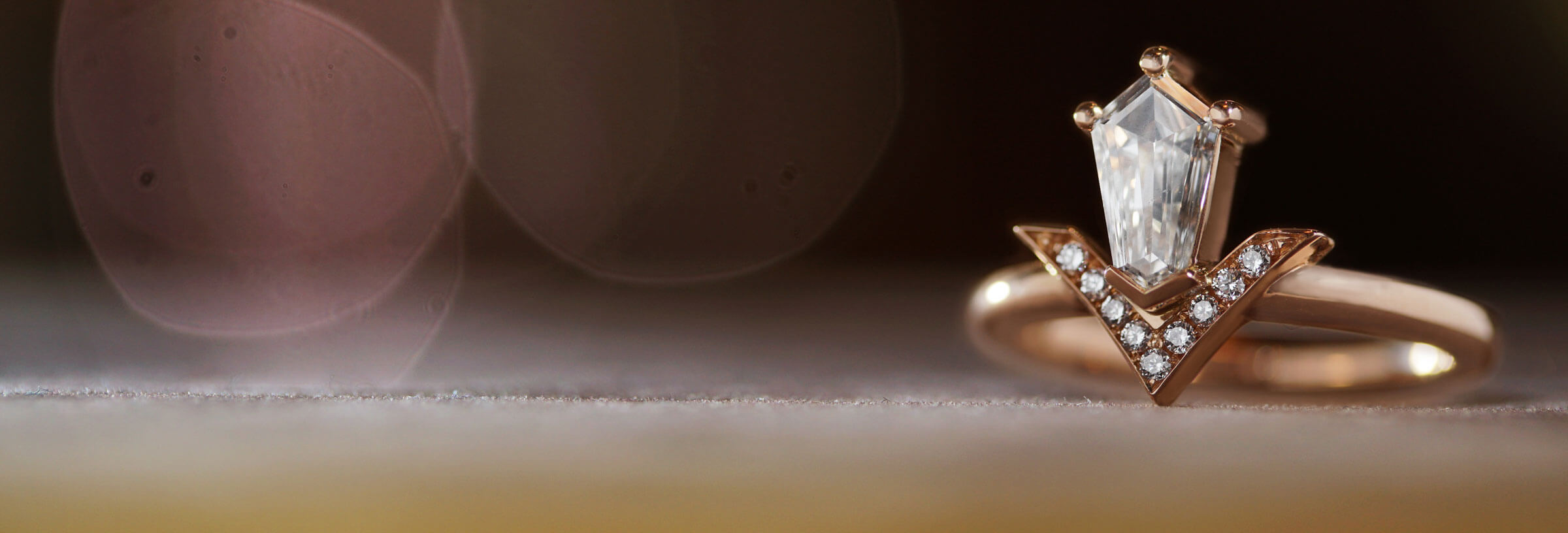 18ct rose gold engagement ring with shield cut diamond