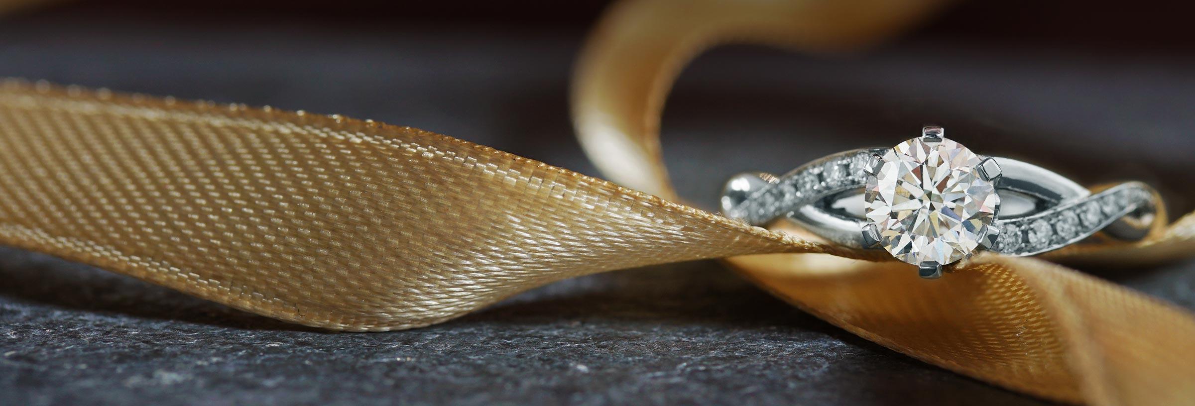 Platinum and diamond delicate twist set engagement ring