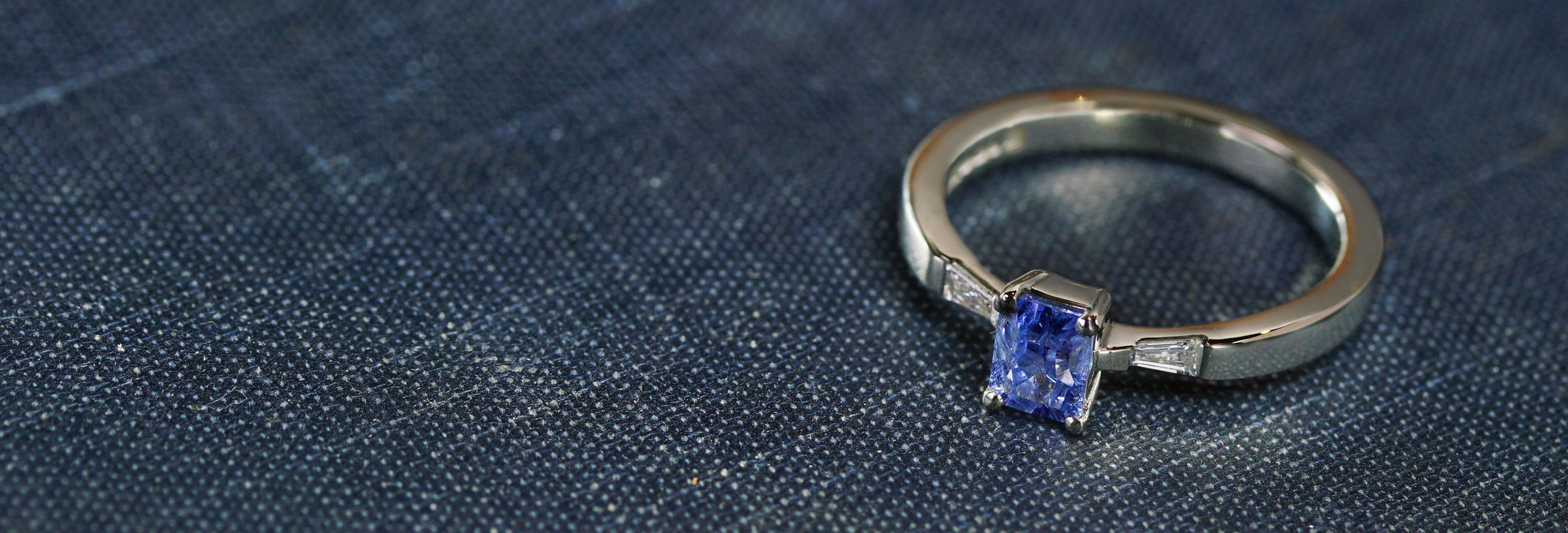 fairtrade-white-gold-diamond-and-light-blue-sapphire-engagement-ring