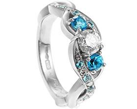 21711-platinum-diamond-and-swiss-blue-topaz-twisting-engagement-ring_1.jpg