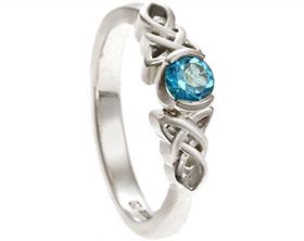 21831-white-gold-and-swiss-blue-topaz-celtic-knot-inspired-engagement-ring_1.jpg