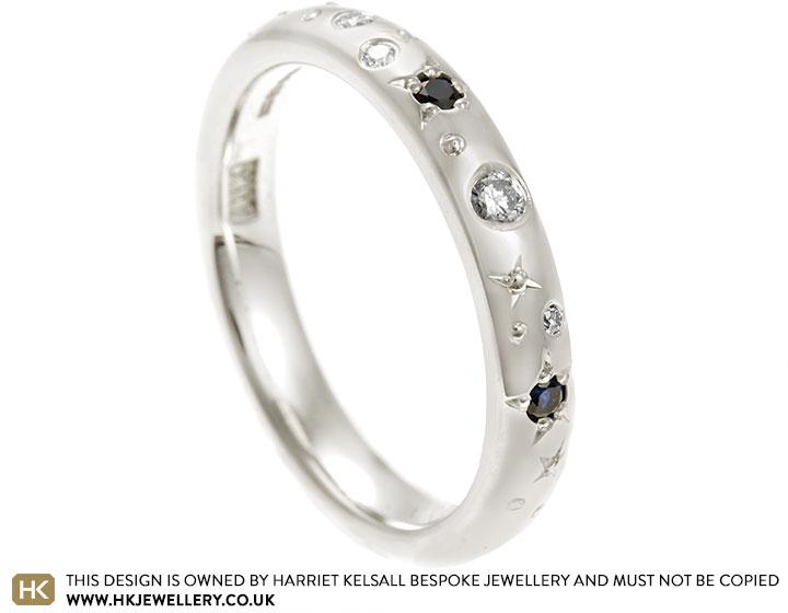 21885-white-gold-diamond-and-dark-blue-sapphire-constellation-inspired-eternity-ring_2.jpg