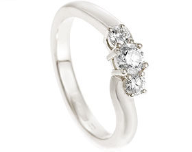 21628-white-gold-and-diamond-trilogy-gentle-twist-engagement-ring_1.jpg