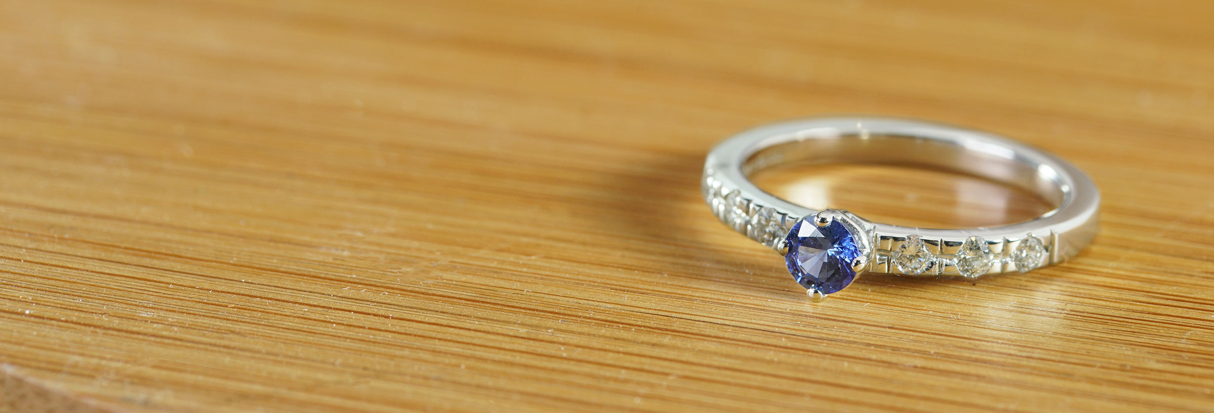 white-gold-sapphire-and-diamond-shoulder-engagement-ring