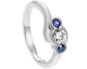 22008-platinum-sapphire-and-diamond-twist-trilogy-engagement-ring_1.jpg