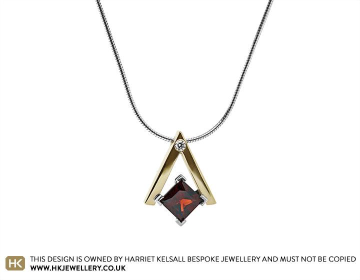 20109-yellow-gold-and-silver-garnet-and-diamond-pendant_2.jpg