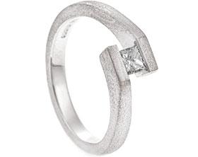21697-white-gold-and-princess-cut-diamond-tension-set-engagement-ring_1.jpg