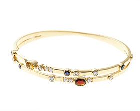 22121-yellow-gold-diamond-sapphire-garnet-tourmaline-and-citrine-bangle_1.jpg